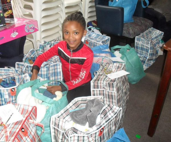 Cape Town's volunteers packing 'Bags for New Beginnings' 2